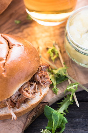 bap: simple steet food, pulled pork bap and beer Stock Photo