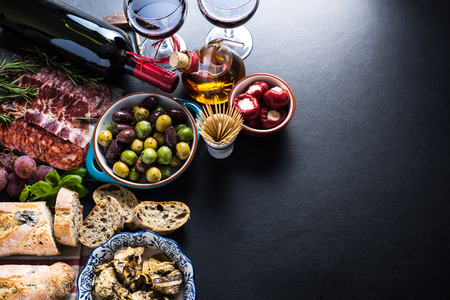 spanish tapas, food border background overhead view