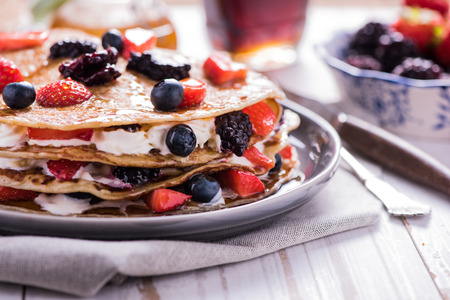 shrove tuesday: Shrove Tuesday, pancake day, with berry fruits Stock Photo