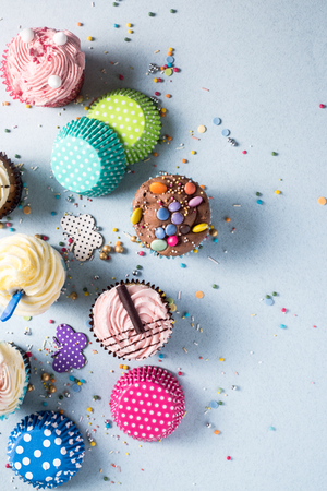 fairy cakes: Vibrant cupcakes on blue background