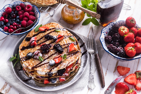 Fresh crepes with fruits and chocolate, from above