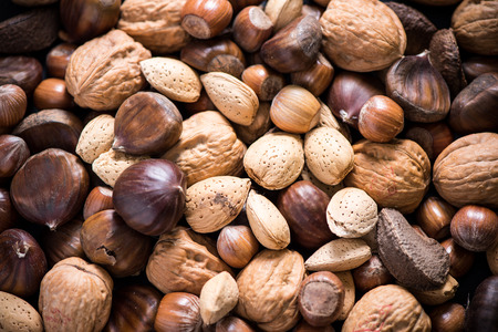 dry food: mixed dry nuts, food background from above