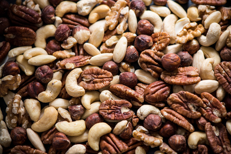 mixed dry nuts, food background from above