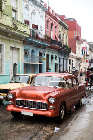 rainy day: Street scene with old car on rainy day in Havana,Cuba Stock Photo