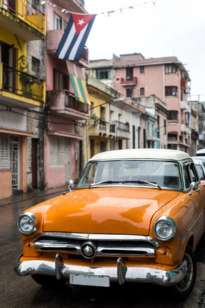 Street scene with old car on rainy day in Havana,Cuba Reklamní fotografie