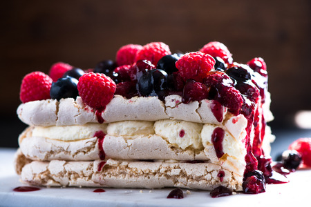 custard flavor: Sweet Pavlova with winter berry fruits Stock Photo