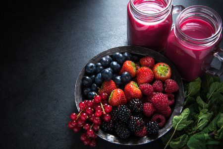 antioxidant: Antioxidant all berries fruit smoothie in mason jat and fresh berries, food border background Stock Photo