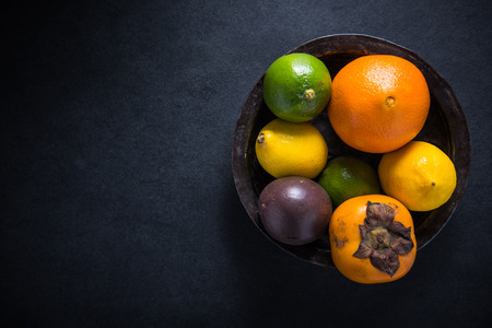 exotic: fresh tropical and exotic fruits in rustic bowl, food border background from above