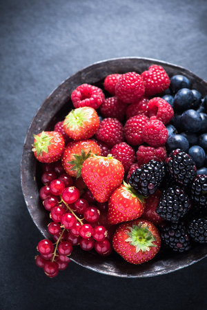 antioxidant: Fresh berries in rustic bowl, antioxidant concept