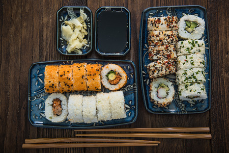 sushi roll: Japanese food, california style rolls from above on wooden table