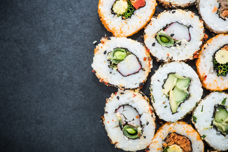 california roll: California sushi style rolls, with raw vegetables, food border background Stock Photo