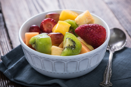 fruity salad: Bowl full of exotic fruits cubes, healthy breakfast concept Stock Photo