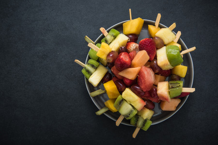 fruity salad: Exotic fruits party snacks, food border background