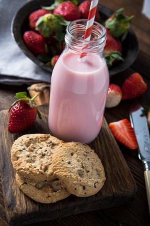 milkshake: Strawberry milkshake with fresh berry on rustic wooden board Stock Photo