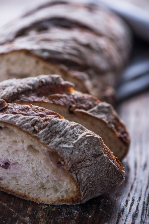 artisan bakery: Sharing homemade bread loaf on vintage table