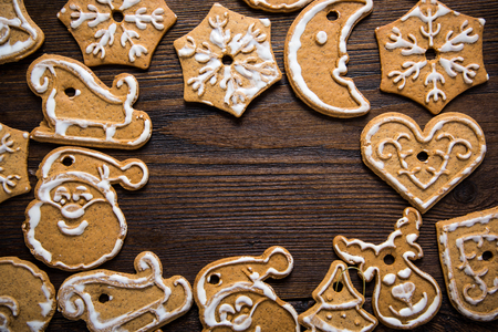 gingerbread cookies: Gingerbread cookies  over wooden background from above Stock Photo
