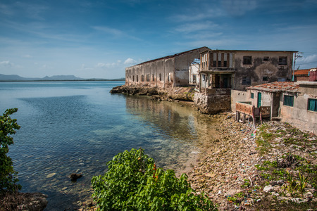 holguin: Bay in old colonial cuban city of Gibara, with old port building Stock Photo