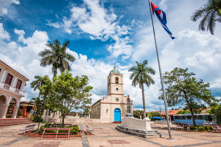 spanish village: Central square in cuban colonia spanish village of Vinales with beautiful sky