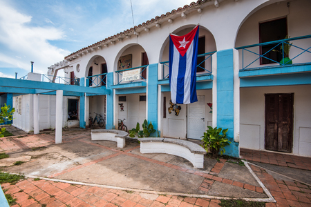 colonial building: Cuban bandera or flag displayed on colonial building