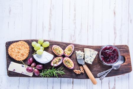 queso de cabra: Farm fresh cheese selection on woden rustic board