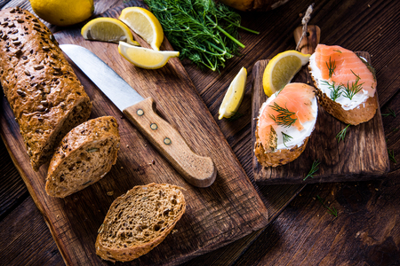 rustic kitchen: Fresh bread with smoked salmon in rustic kitchen