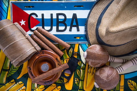 cuban culture: Cuban related items on vibrant background from above, travel concept