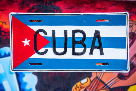 cuban culture: Cuban flag on vibrant background, travel concept