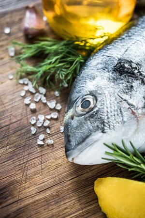 Whole fresh fish with lemon and herbs
