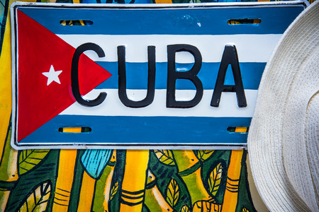 cuban culture: Cuban flag and straw hat on vibrant background