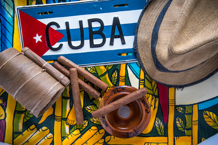 Travel to Cuba concept background, hat, cigars and flag