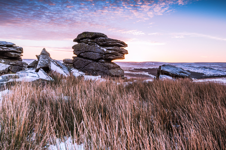 heathland: Granite tor on frosty morning    at sunrise in Dartmoor, England. Stock Photo
