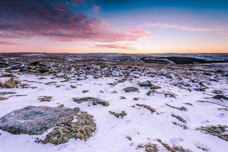 granite park: Snow on granite hills at sunrise in Dartmoor National Park, Devon, UK.