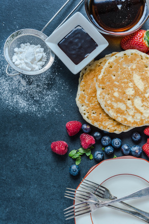 brunch: Perfect brunch, pancakes and berry fruit with honey Stock Photo
