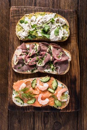 Clean eating, healthy breakfast sandwich on wooden board