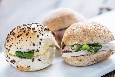 bap: Deli sandwich selection on white board Stock Photo