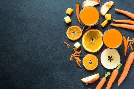 carrot juice: Healthy diet smoothie ingredients, food border background Stock Photo