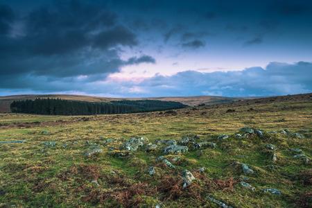 devon: Dramatic clouds over wild moorland landscape in Devon, UK