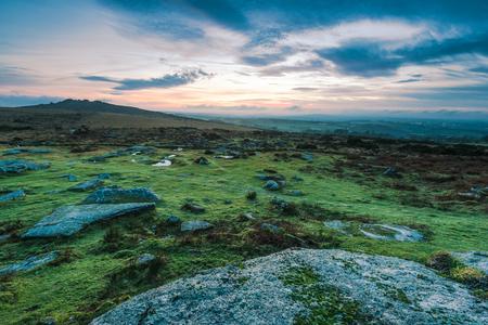 granite park: Granite rocks in Dartmoor Park , UK at sunset Stock Photo