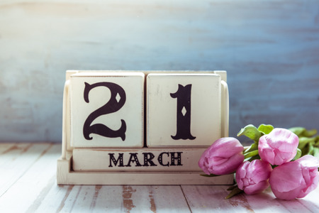 march: 21st March first day of Spring, decoration on wooden table Stock Photo
