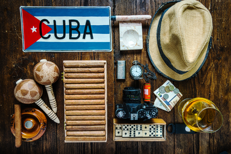 Items related to travel to Cuba concept , from above. Flat lay, cigars,flag,hat and vintage camera.Cuba vacation concept.