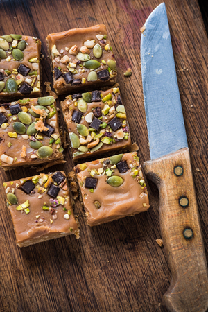 flap: Homemade diet flap jacks with pistachio and nuts, flat squares from above Stock Photo
