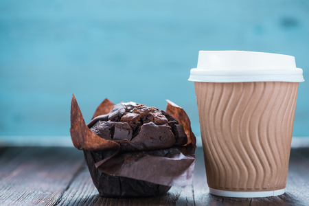 muffin: Take away coffe and chocolate muffin on wooden background with copy space for text or advert