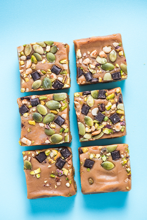 jacks: Homemade diet flap jacks with pistachio and nuts, flat squares from above Stock Photo