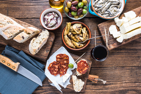 Traditional tapas served for share with friends in restaurant or bar.
