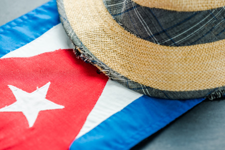 Vacation in Cuba, Hat and national flag. Travel background.
