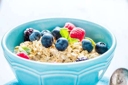 light diet: Light diet cereal breakfast with sumer fruits, wellbeing concept. Overhead with copy space for recipe. Stock Photo