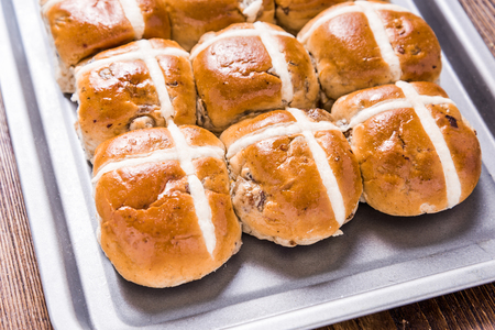 easter cross: Easter hot cross bun on baking tray Stock Photo