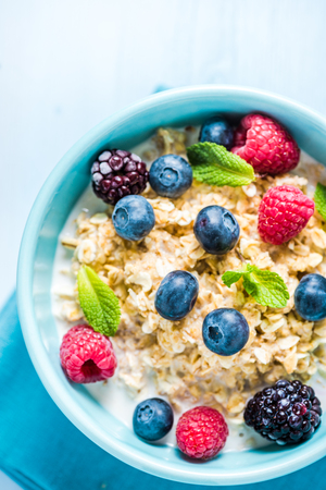 light diet: Tasty and light diet cereal breakfast with sumer fruits, fresh milk and honey. Diet concept and wellbeing.