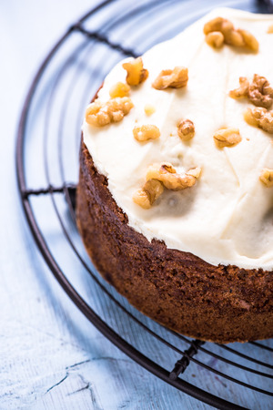 carrot cake: Homemade traditional carrot cake topped with walnut Stock Photo