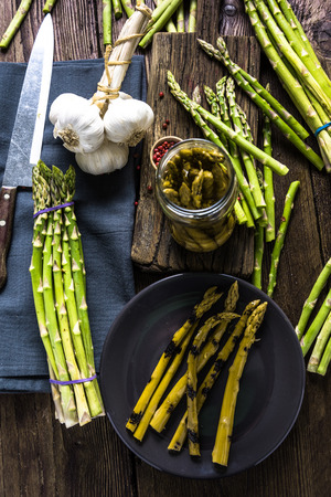 fermented: Fermented and grilled fresh asparagus, food preserved in new way. Stock Photo